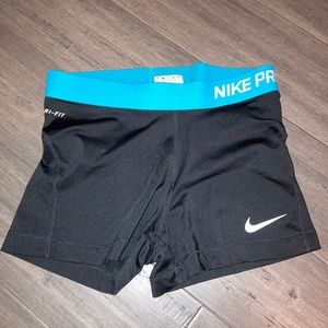 Black Nike pros with Teal Band